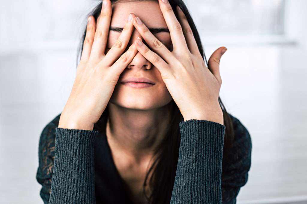 Woman with hands on face in distress. Sometimes, we don't know we are dealing with depression. Get support from our team of depression therapists today. Begin depression treatment in Riverside, IL, Chicago, Berwyn, Champaign, and anywhere via online therapy in Illinois!