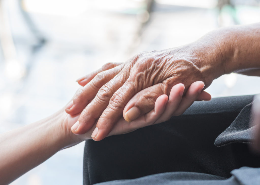 Older person holding younger persons hand. We all deal with mental health issues, no matter the age. Get support in depression treatment in riverside, il with our depression therapists soon! Call now!