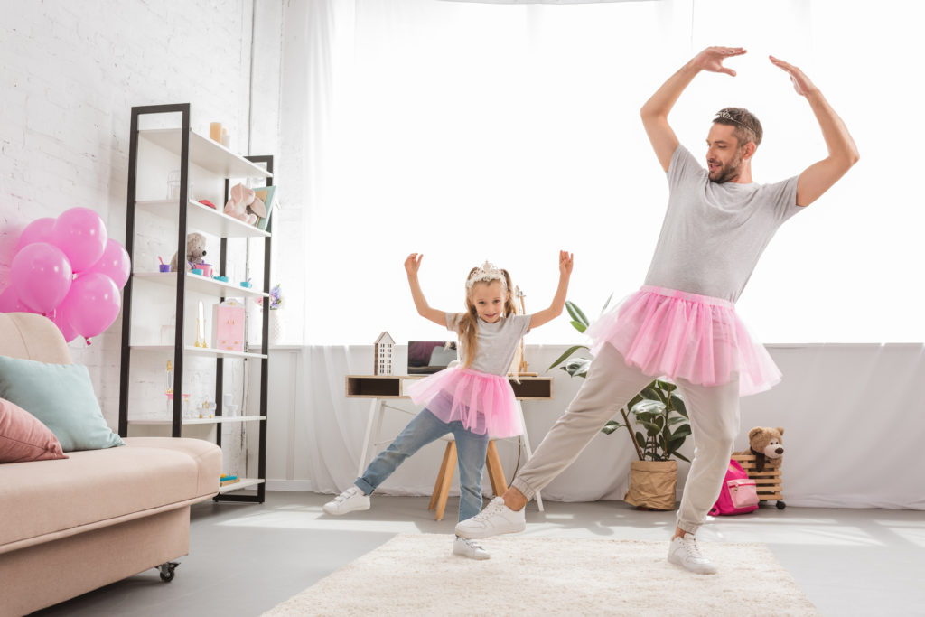 Dad wearing tutu, practicing ballet with young daughter. Being a single parent or a working parent can be challenging on your relationship. If you or your partner need help, try counseling for parents in riverside, il, Chicago, Berywn.