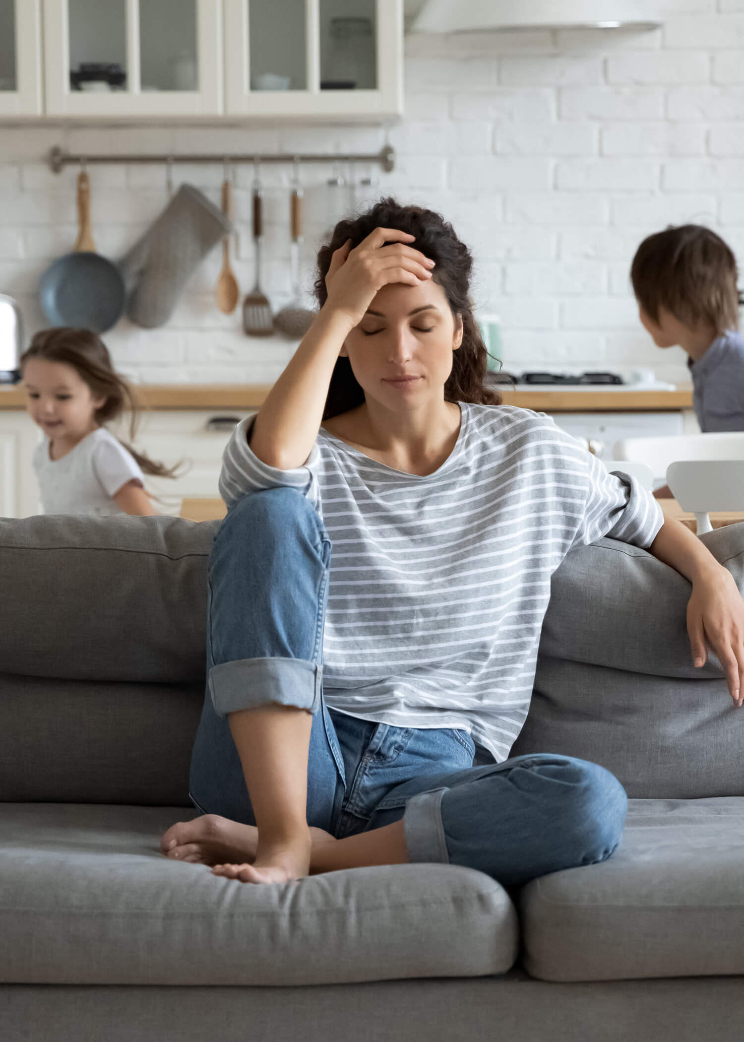 Woman holding head in distress as kids play behind her. If you're feeling anxiety from this past year or have dealt with it for other reasons, an anxiety therapist can help. Try getting support for postpartum anxiety, health anxiety, and more. Begin anxiety treatment in Riverside, Il.