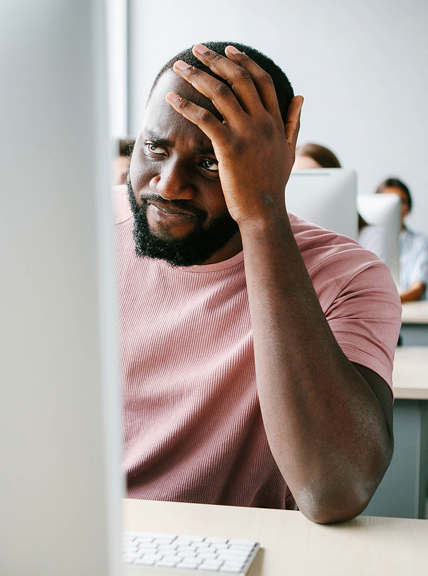 Black man in pink shirt holding head in distress. When you're looking for guidance with stress, stress therapy in Riverside, Il, Chicago, and Lyons today. Begin stress management therapy and be to recover.