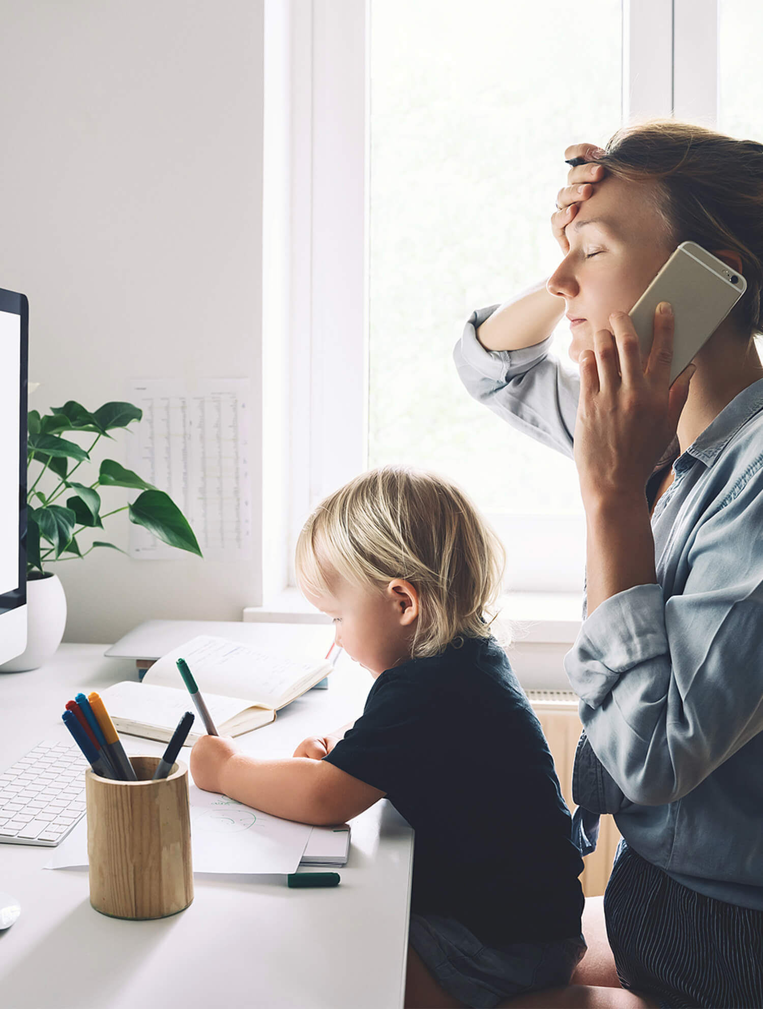Mom in distress on phone while son draws. If you're looking for stress management therapy, CBT for stress can help. Consider working with a stress therapist to develop healthy coping skills! Begin stress therapy in Chicago, Riverside, IL, Berwyn, or Forest Park soon!